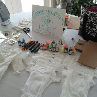 """Baby Shower - Onesie Station We spelled """"onesie"""" wrong but the idea was still a hi!  Some of the ladies at the baby shower were so talented!"""