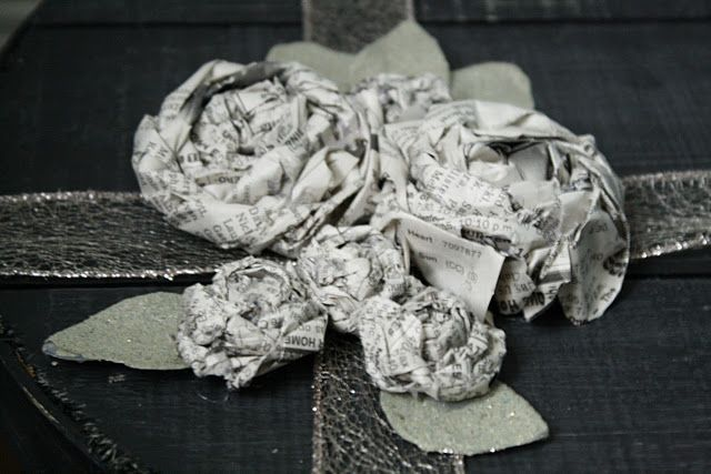 rolled newspaper roses