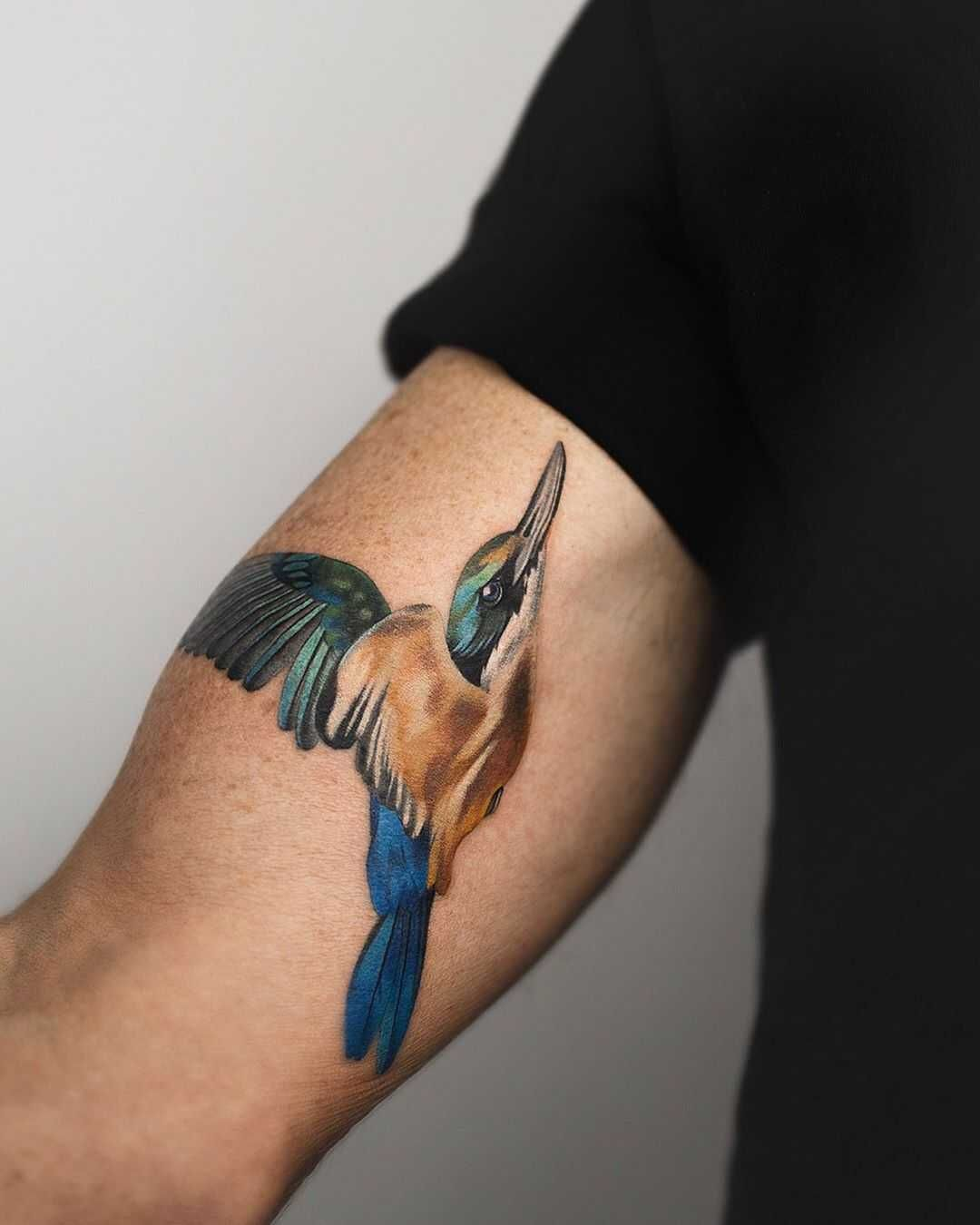Sacred Kingfisher tattoo by Rey Jasper inked on the right