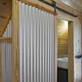 A Simple Corrugated Metal Sliding Barn Door Interior