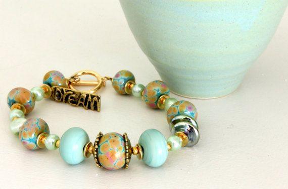 "Copper Green Bracelet. Lampwork Bead ""Dream"" Bracelet. Glass Bead Jewelry. Lampwork Jewelry. Rustic Bronze Charm.. $75.00, via Etsy."