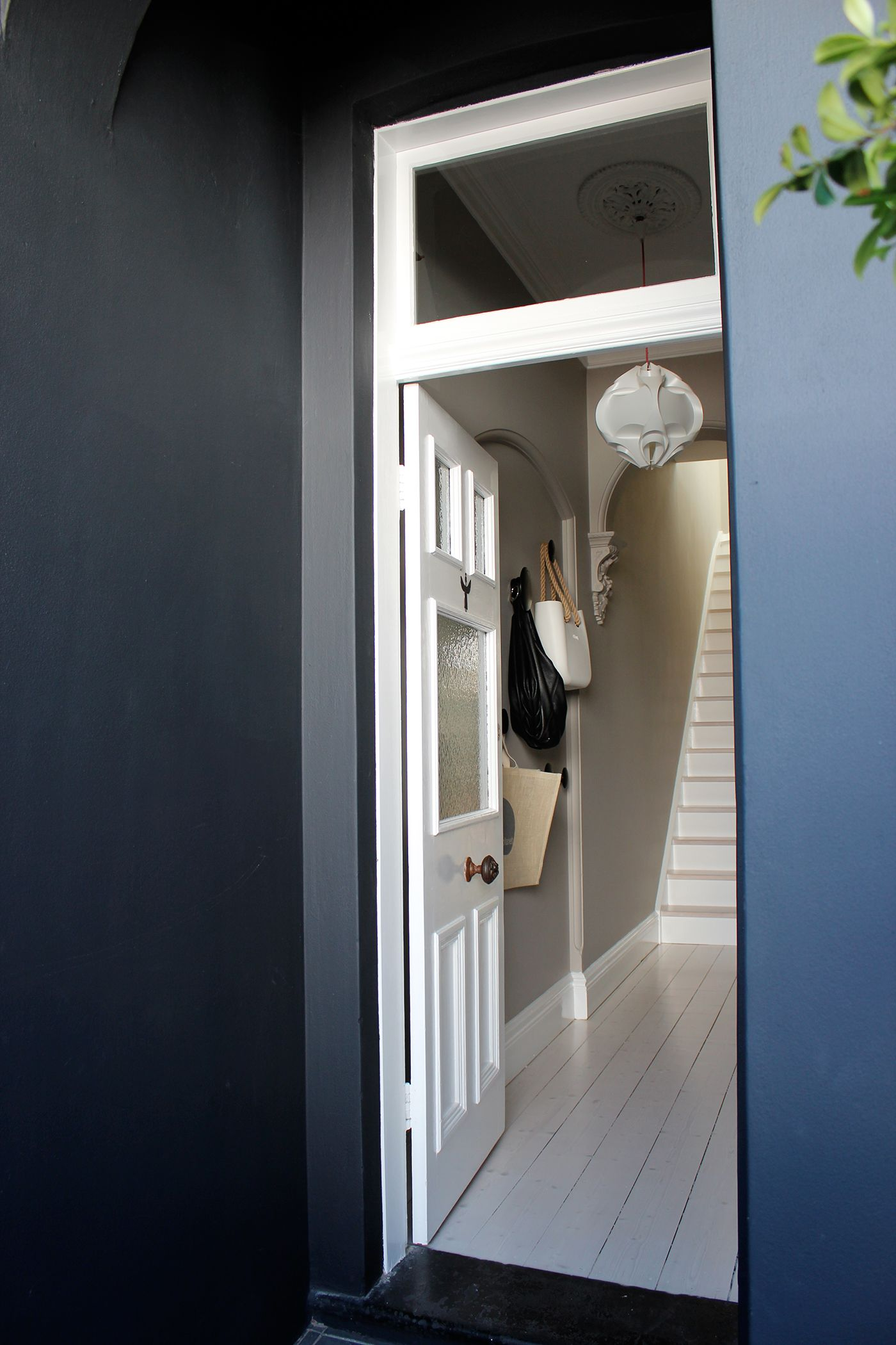 White entrance door white doors black walls porters paint stone