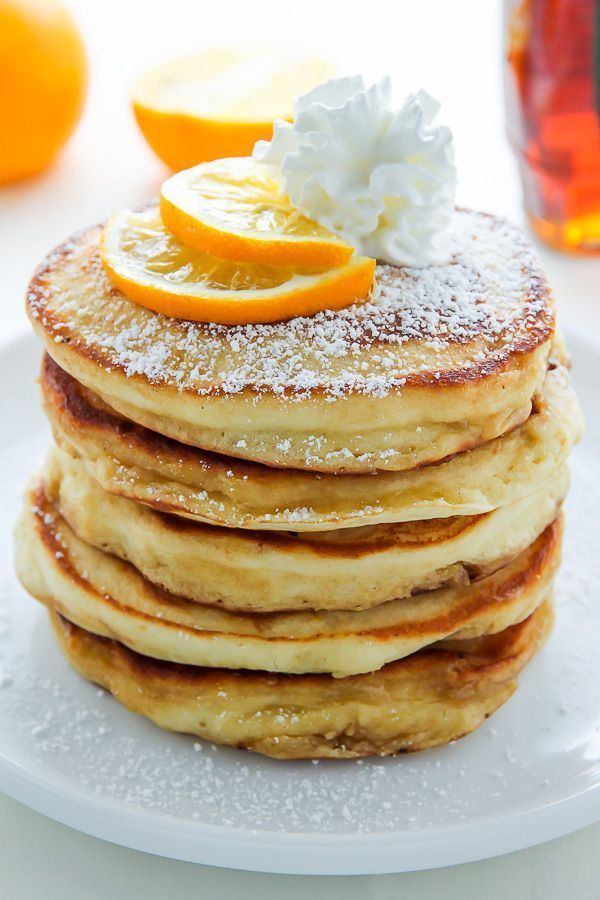 Super soft and fluffy Lemon Ricotta Pancakes made from scratch! Bonus: This recipe is freezer friendly. #pancakes #lemon #ricotta #breakfast #Christmasrecipes
