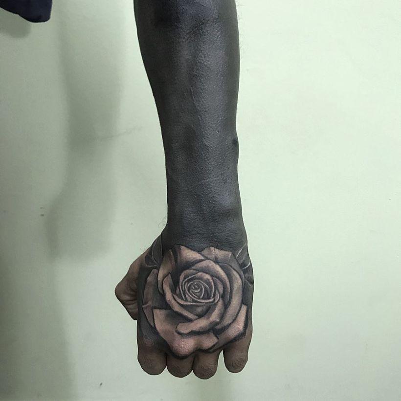 These Striking Solid Black Tattoos Will Make You Want To Go All In Black Tattoos All Black Tattoos Black Sleeve Tattoo