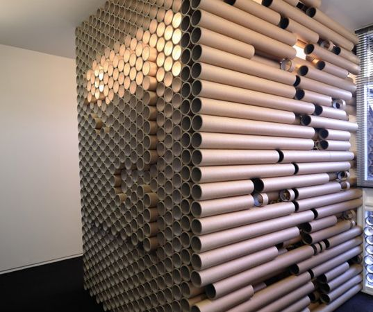 tube office. zouk architects repurpose shipping materials into paper tube office a