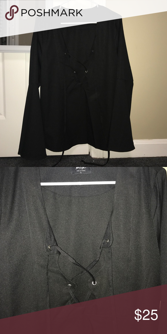 Lace up long sleep Nasty Gal top Super trendy bell sleeved long sleep top from Nasty Gal. Size L. Never worn before but the tags are no longer on the top. Nasty Gal Tops Tunics
