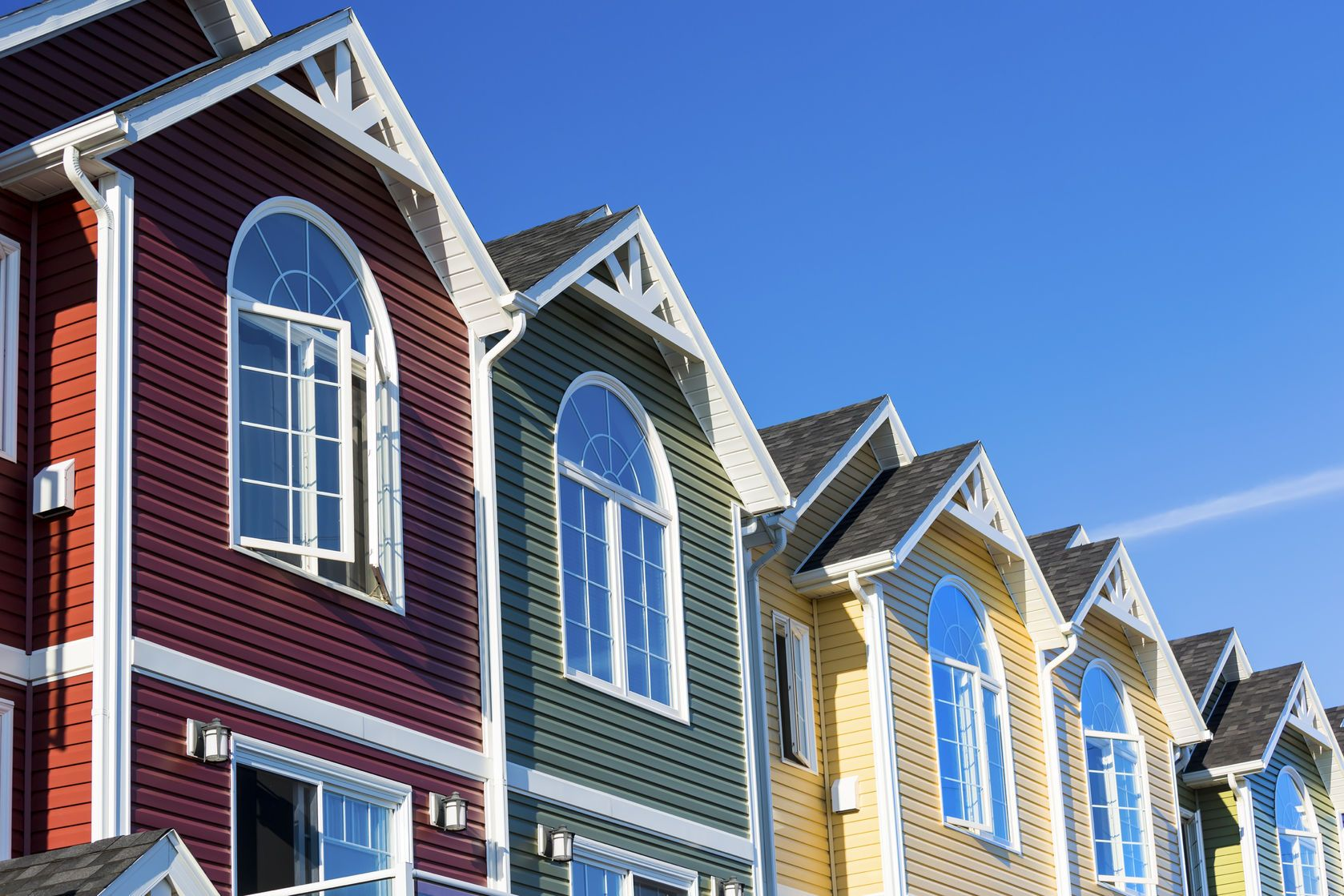Row Of Colorful Townhouses With Varied Colored Vinyl Siding Photo Remodeling Vinyl Siding House Siding Materials House Siding