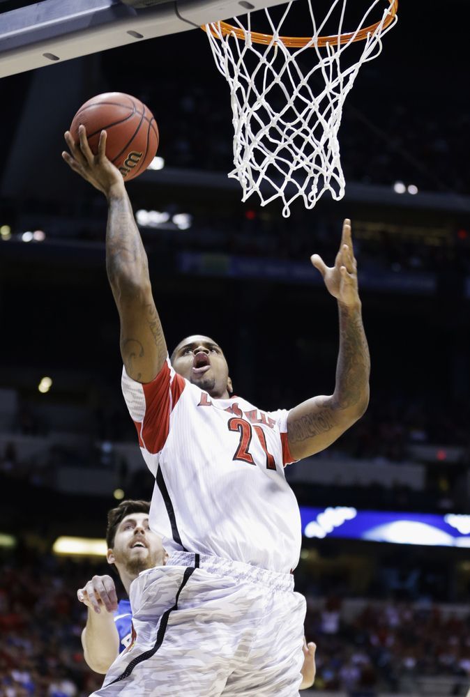 Louisville's Chane Behanan (21) lays the ball up during the first half of the Midwest Regional final against Duke in the NCAA college basketball tournament, Sunday, March 31, 2013, in Indianapolis.