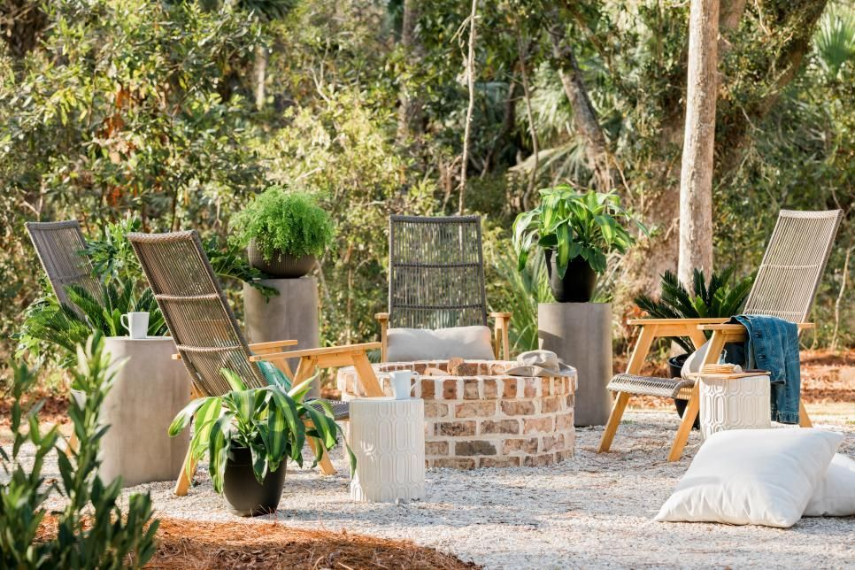 A fire pit area with seating for four, curated garden accessories, a