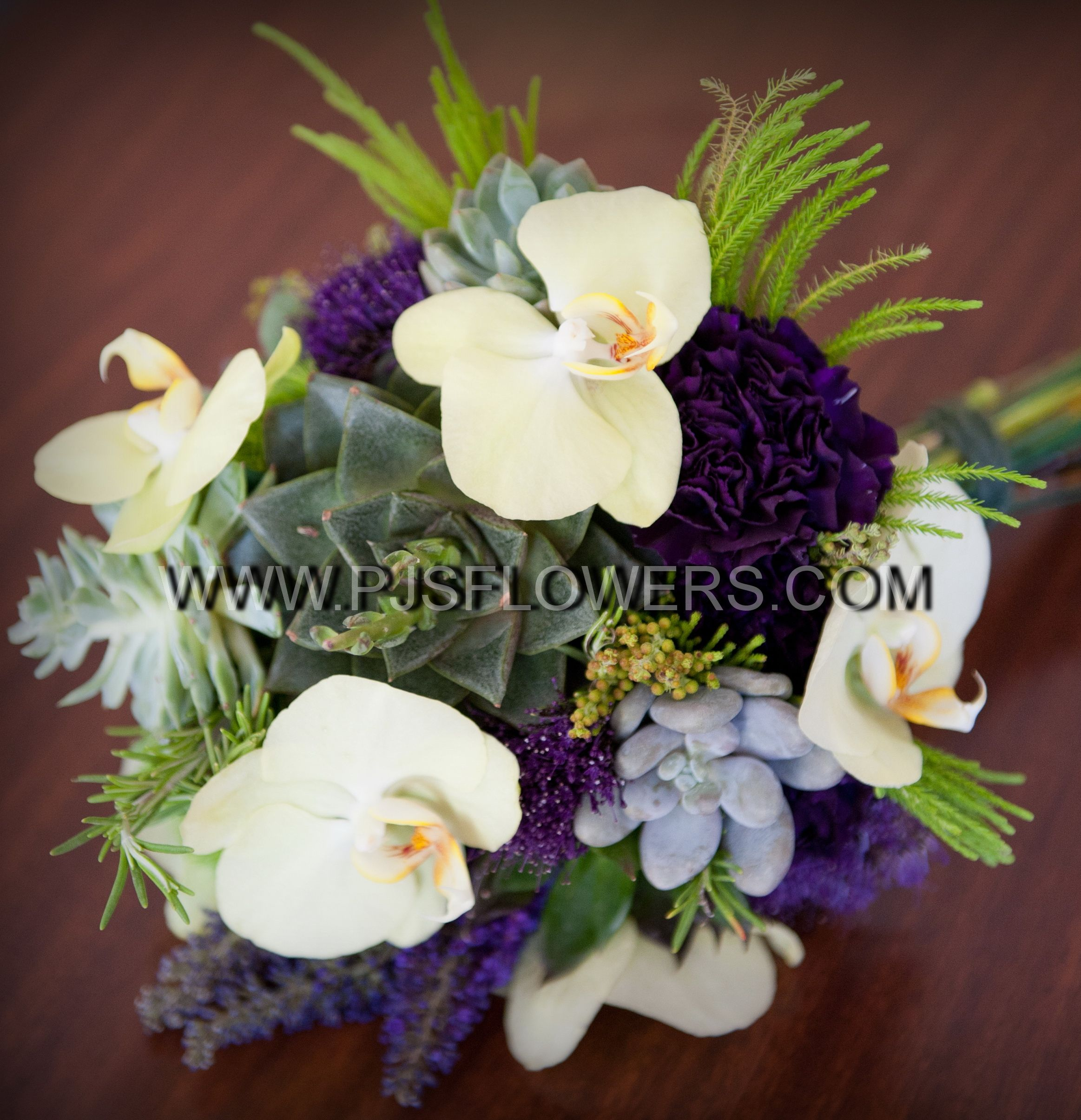 Succulents and phalaenopsis orchids with purple accents wedding
