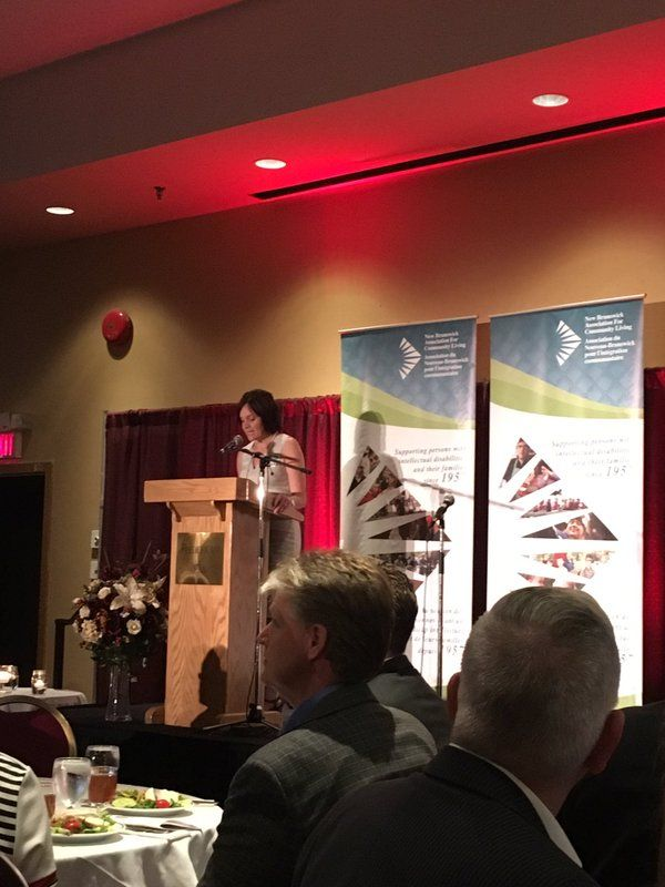 Board Member Suzanne Desrosiers Opens New Brunswick Association For Community Livings Changing Lives Luncheon