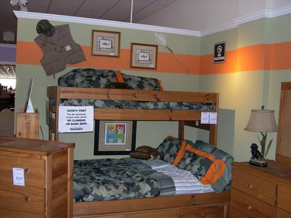 Boys room: Love the camo and orange. The gear on the walls are ...