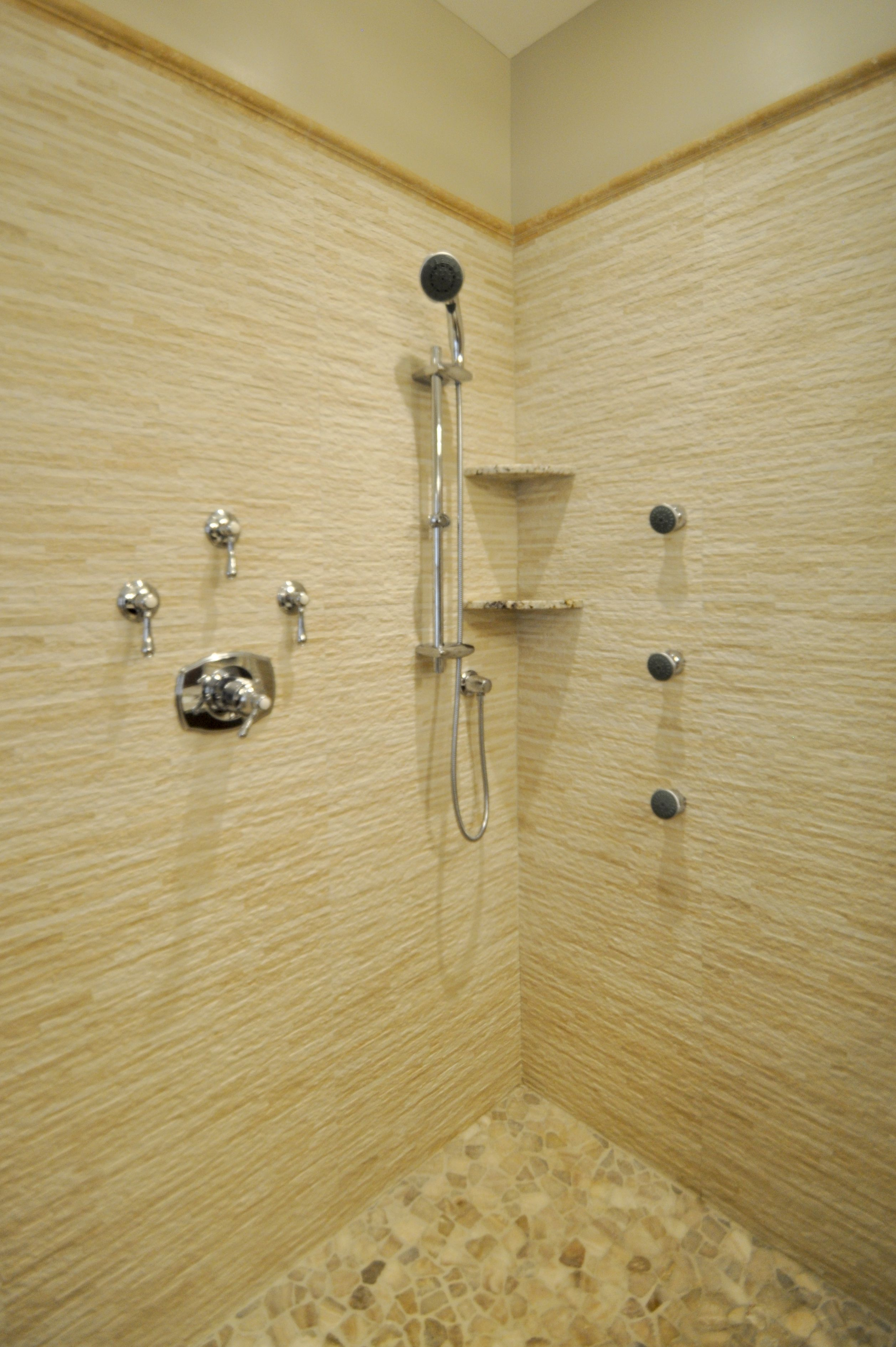 Master shower with rain head, shower wand, body sprays, bench seat ...