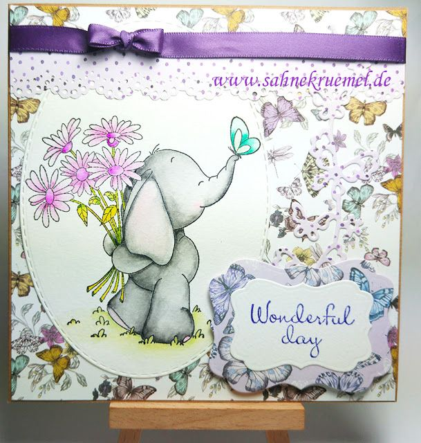 """Elephant with Bouquet"" Whimsy Stamps; Paper Pad ""Paper Flowers"" First Edition; Martha Stewart; ""Butterfly Cascade"" Wild Rose Studio; Ribbon American Crafts; Sentiment Scrapberrys; ""XXL Ovals"" Crealies; Darice dies"