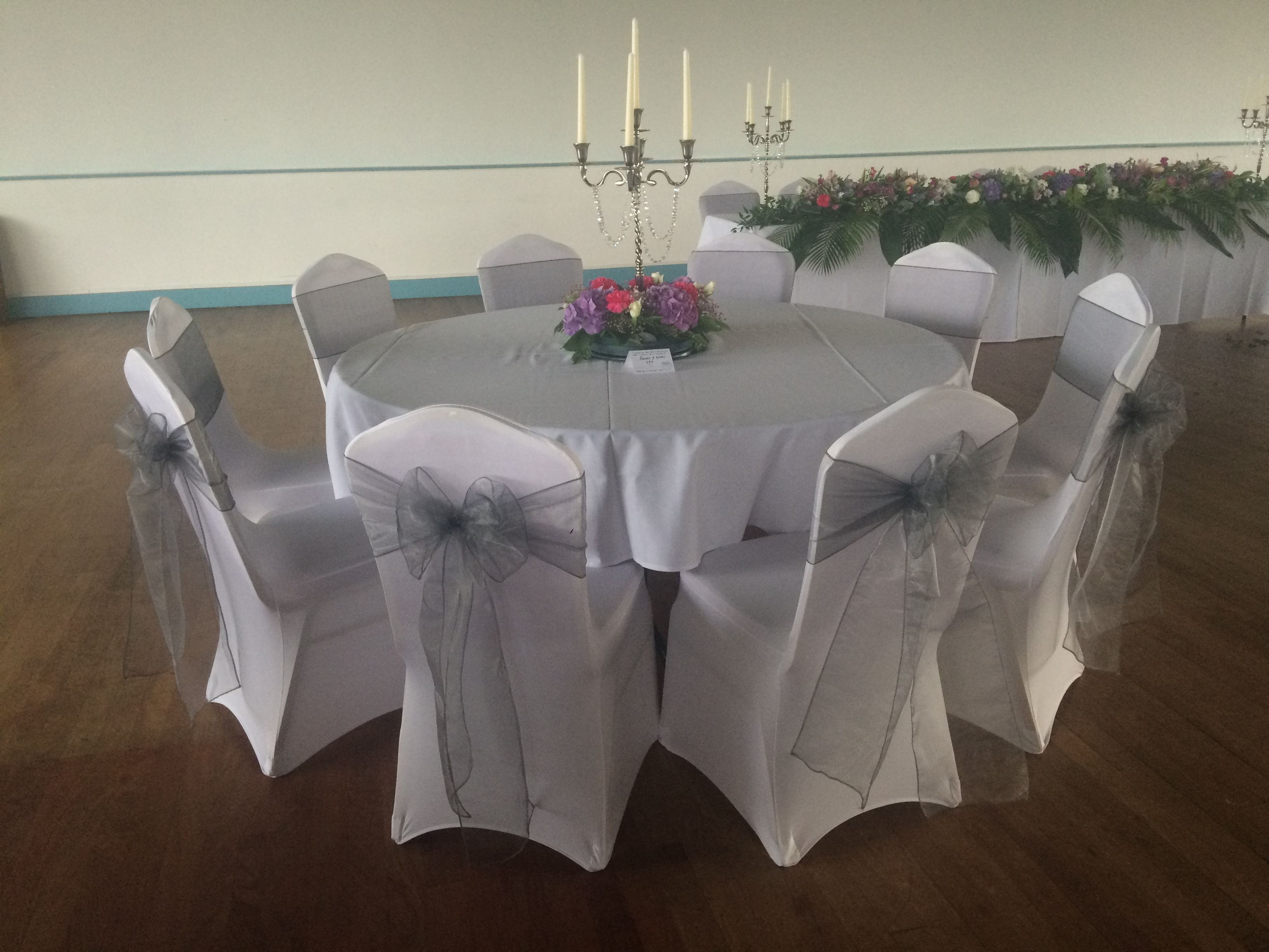 Chair Covers And Silver Organza Sashes At A Wedding Reception At The Patti Raj Swansea Venue Chair Covers Wedding White Chair Covers Seat Covers For Chairs
