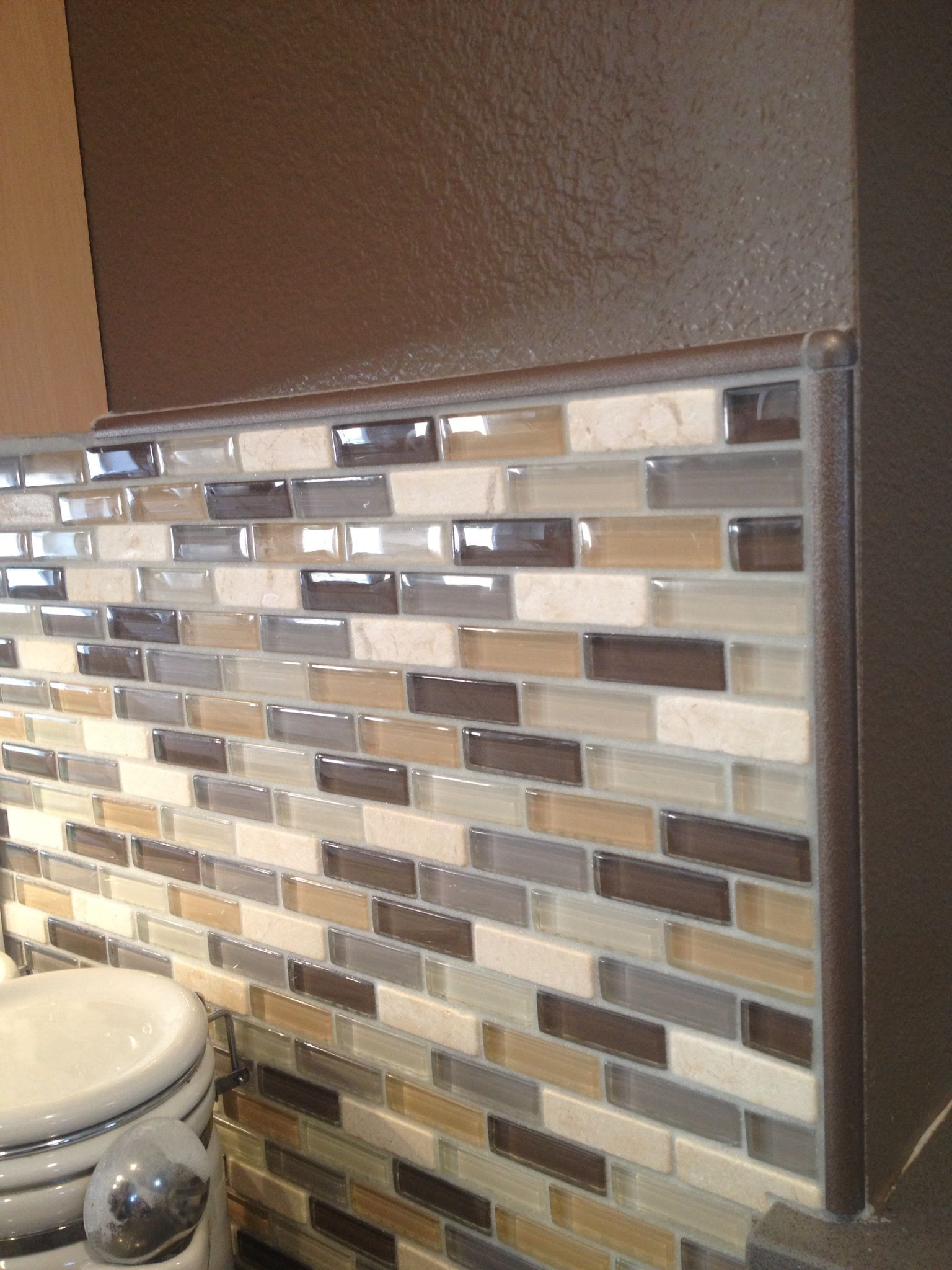 Gl Mosaic Backsplash In Neutral Colors Complete With Schluter Edge Profile Pieces