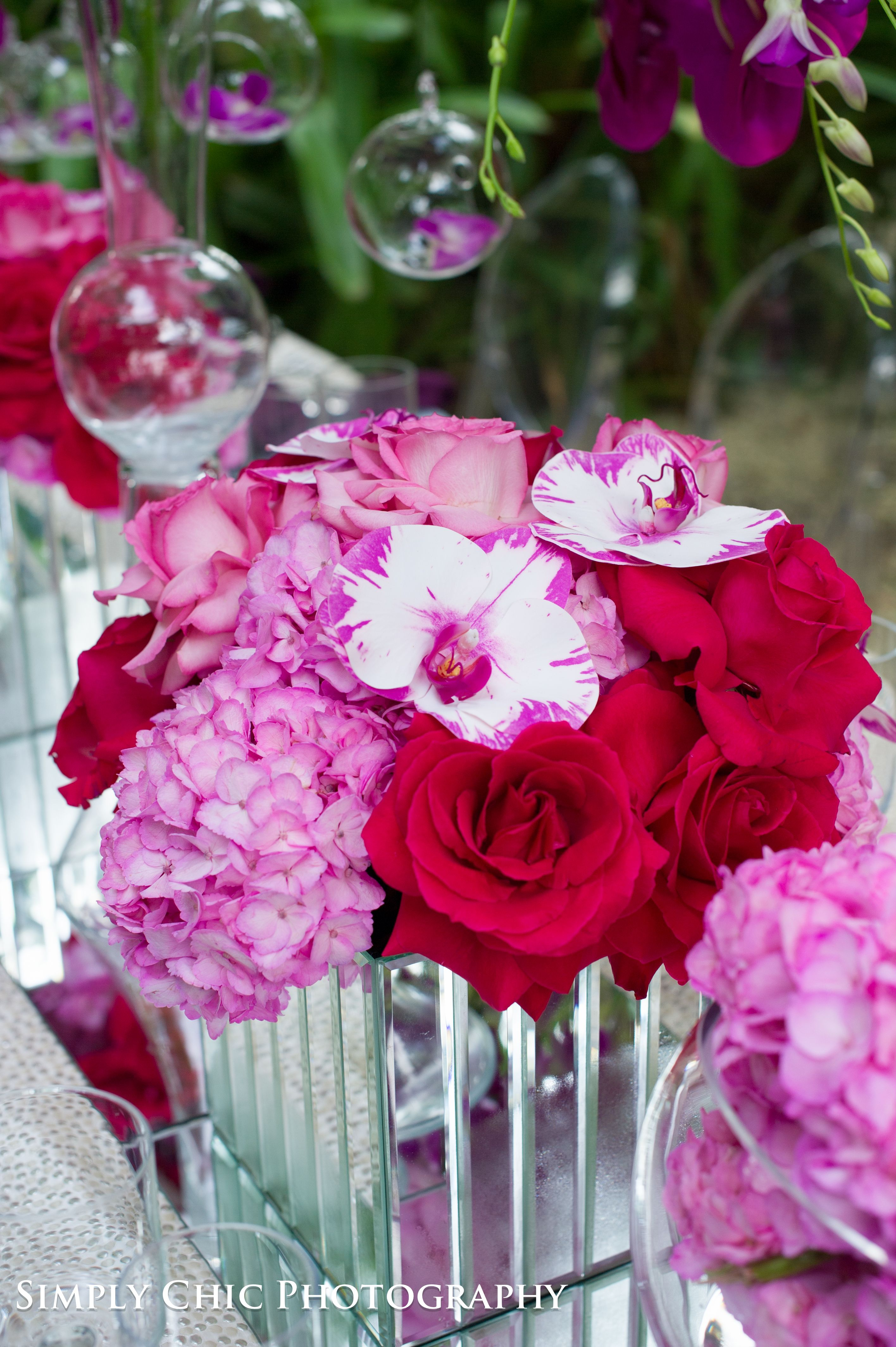 Pink hydrangeas, red roses and bicolor orchids. Its all on the ...