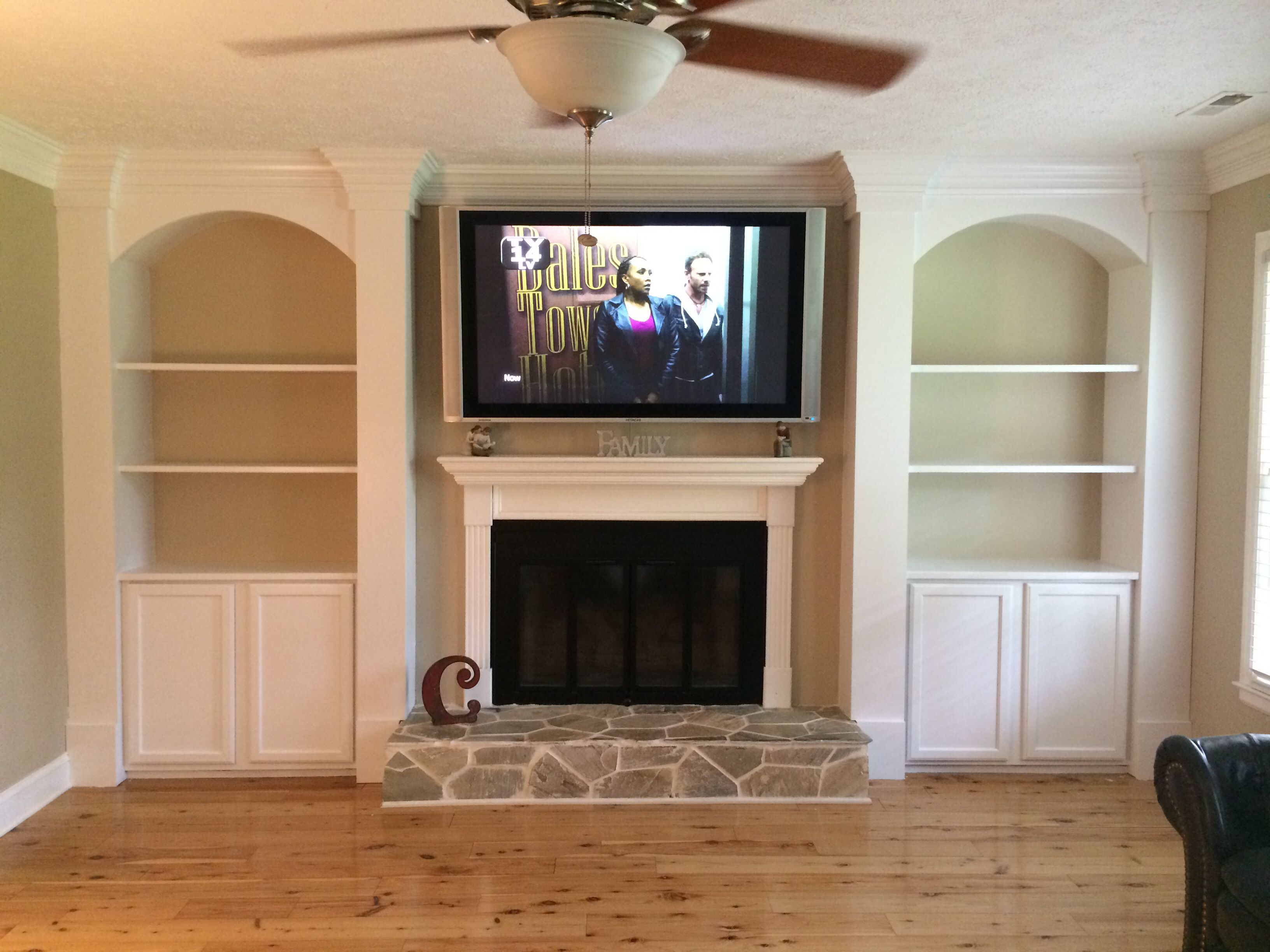 Superior Cabinet And Shelves Beside Fireplace.