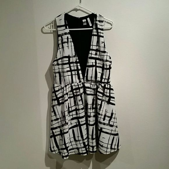 Free Press Dress Black and white empire waist dress. Size large. Worn only once for New Years Eve. Very low cut and may be worn either a bralette or cami underneath. About mid-thigh length. Machine wash cold, hang dry. Free Press Dresses Mini