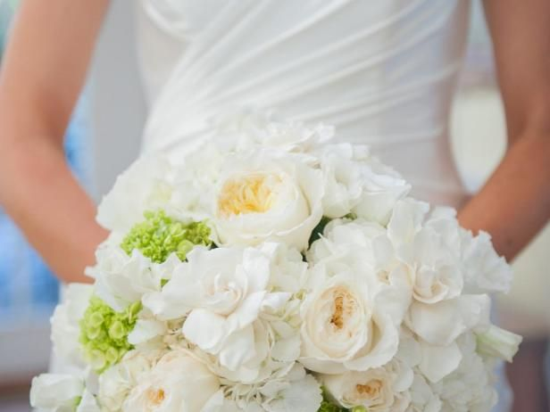 This bouquet features viburnum, Patience garden roses, Polo roses, gardenia,  lisianthus ,  ranunculus ,  hydrangea  and was designed by  Soirée Floral . Photo by  Brea McDonald .