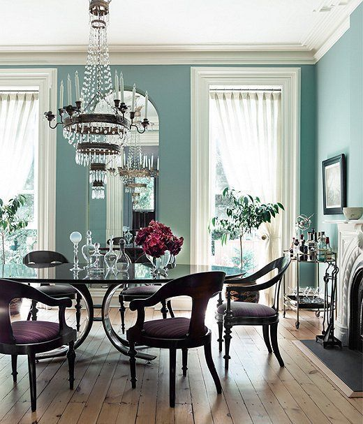 A formal dining room takes a turn for the tropical with this happy-go-lucky coastal-blue hue on the wall.