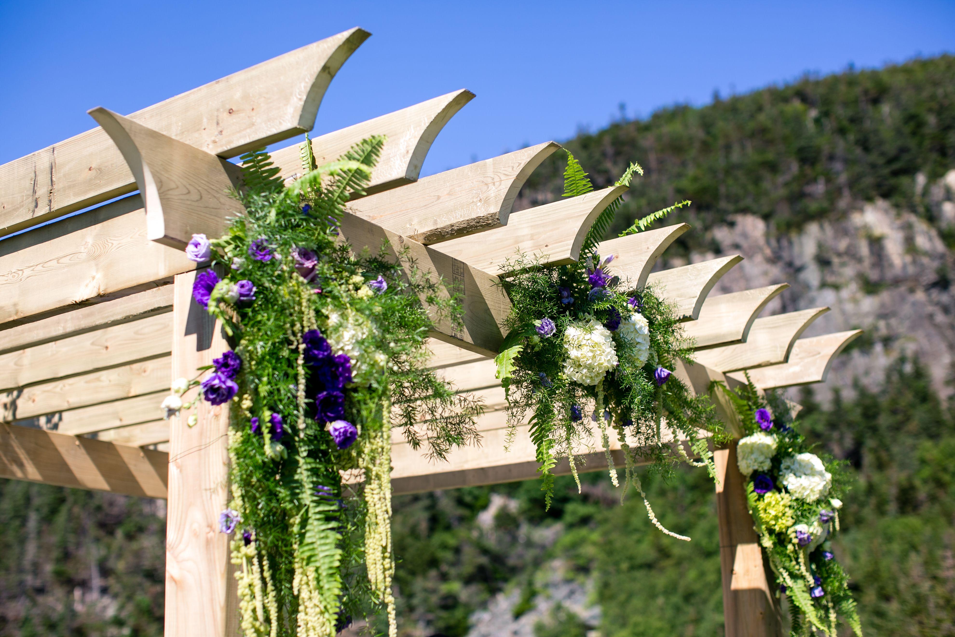 Wedding Arbor# rustic# purple# green# draping flowers# outdoor wedding# Conception Bay Newfoundland#