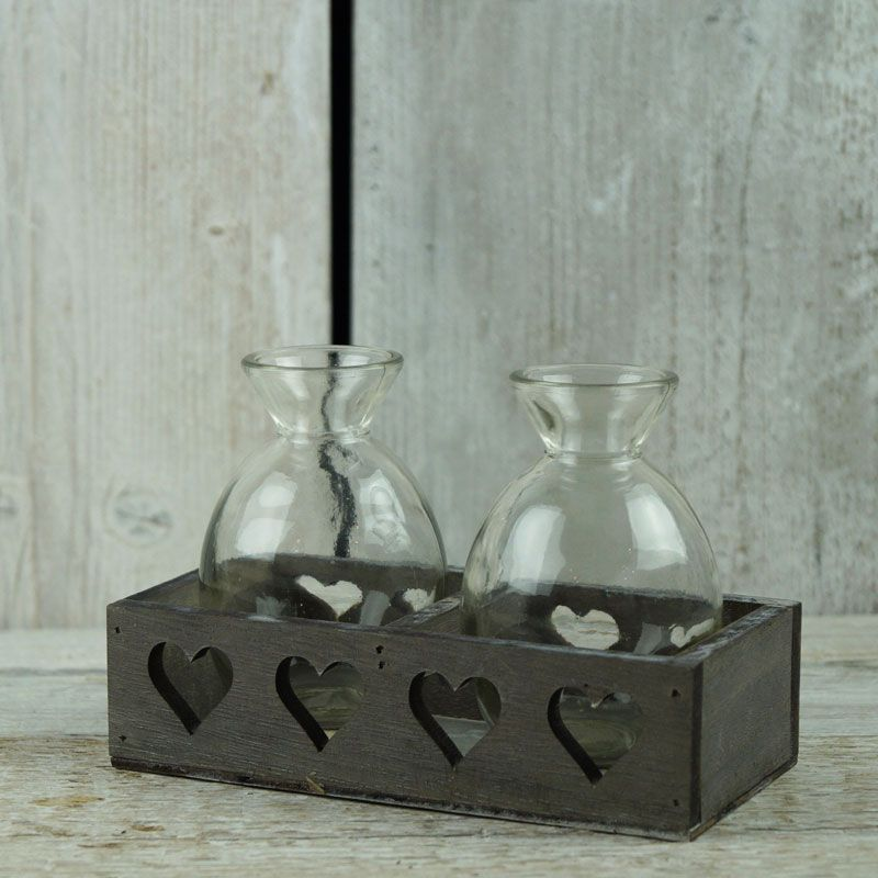 Charming set of bottles in a greywashed tray with cut out hearts. http://www.thesatchvillegiftcompany.co.uk/products/home-accessories