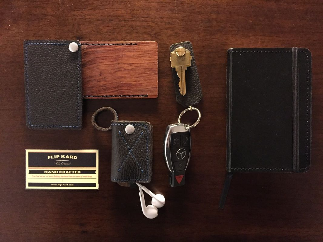 Everyday essentials - leather RFID credit card wallet, headphone wrap, minimalist keychain, notebook. Handmade by Flip Kard.