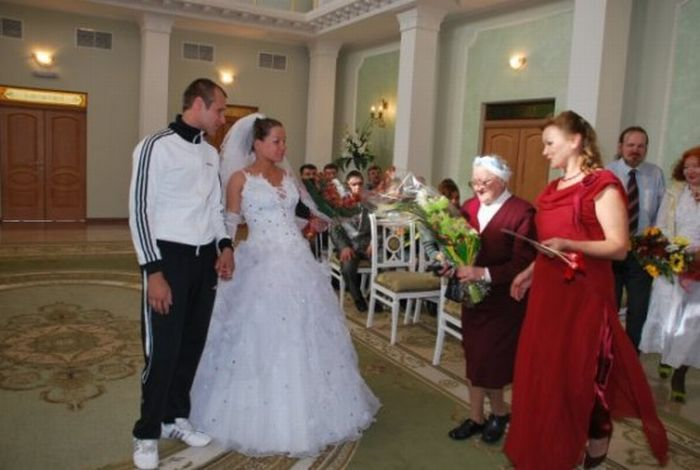 Funny wedding photo. Why is he in a track suit???   Fun, Funny ...
