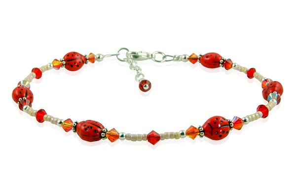 This handmade Fire Opal Ladybug Beaded Braceletcombines redCzech ladybug glass beads, fire opal and red Swarovski Austrian crystals, cream seed beads, and ste