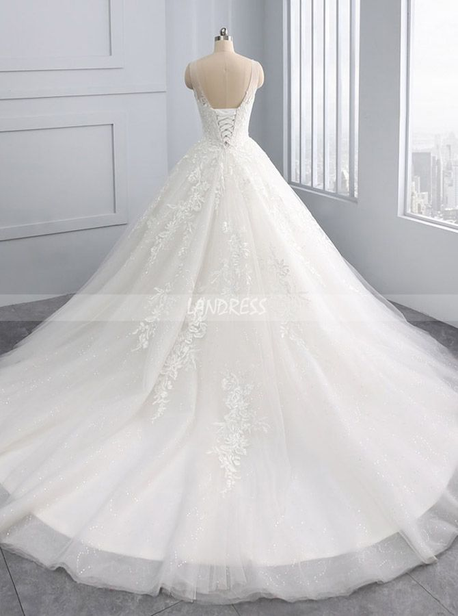 """Feature:ball gown wedding dresses princess,wedding dresses corset,elegant wedding dresses.Unforgettable and exciting, this stunning bridal gown is a beautiful selection for your big day. Exquisite beaded lace appliques adorned the dress create a marvelous and attractive look. The illusion neckline and amazing chapel train make the dress more charming and eye-catching. This princess wedding dress can be custom made with no extra cost. Description 1, Color: picture color or other color, there are 126 colors are available, please contact us for more colors, please ask for fabric swatch. If you choose custom color,please note the color name when place the order or send us by email. (Send to landressofficial@gmail.com) 2, Size: standard size or custom size, if dress is custom made, we need to size as following(Send to landressofficial@gmail.com). Bust:______ cm/inch Waist:______cm/inch Hip:_______cm/inch Hollow to Floor:_______cm/inch Height with shoes:_______cm/inch Occasion Date:_______ Dress color:_______ Delivery time: All of the dresses don't come """"on the shelf"""" (Our Dresses are all custom-made). We strongly recommend you to select """"Custom Size"""" to ensure the dress will fit you when it arrives. By the way, you can order them in any size and color. Rush order: within 15 days, please add $25.00. Normal time: Within20days (From May to Dec) Around25 days (From Jan to April), it's busy season together with spring festival holiday, so produce time will be long. Packing: in order to save your shipping cost, each dress will be packed tightly with water proof bag . Shipping: by UPS or DHL or some special airline. Payment: Paypal, bank transfer, western union, money gram and so on. Princess Tulle Wedding Gown,Classic Wedding Gown Corset,11684"""