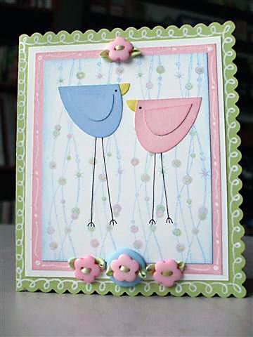half of a heart punch? darling bird card!  & Button embellishments!  =]  This is too cute.