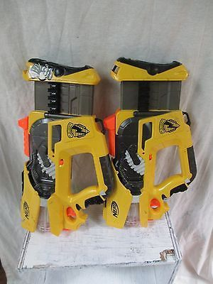 Great set / pair / lot of NERF FIREFLY soft dart blaster toys, perfect to  play with a partner or at a party! Wear as shown, functional and fun!