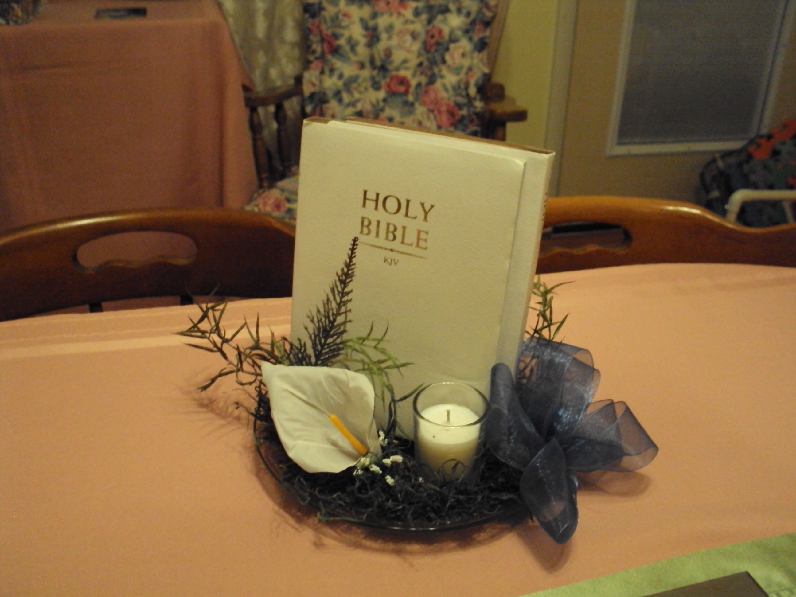 Bibles Used To Make Table Decorations For Bridal Shower And