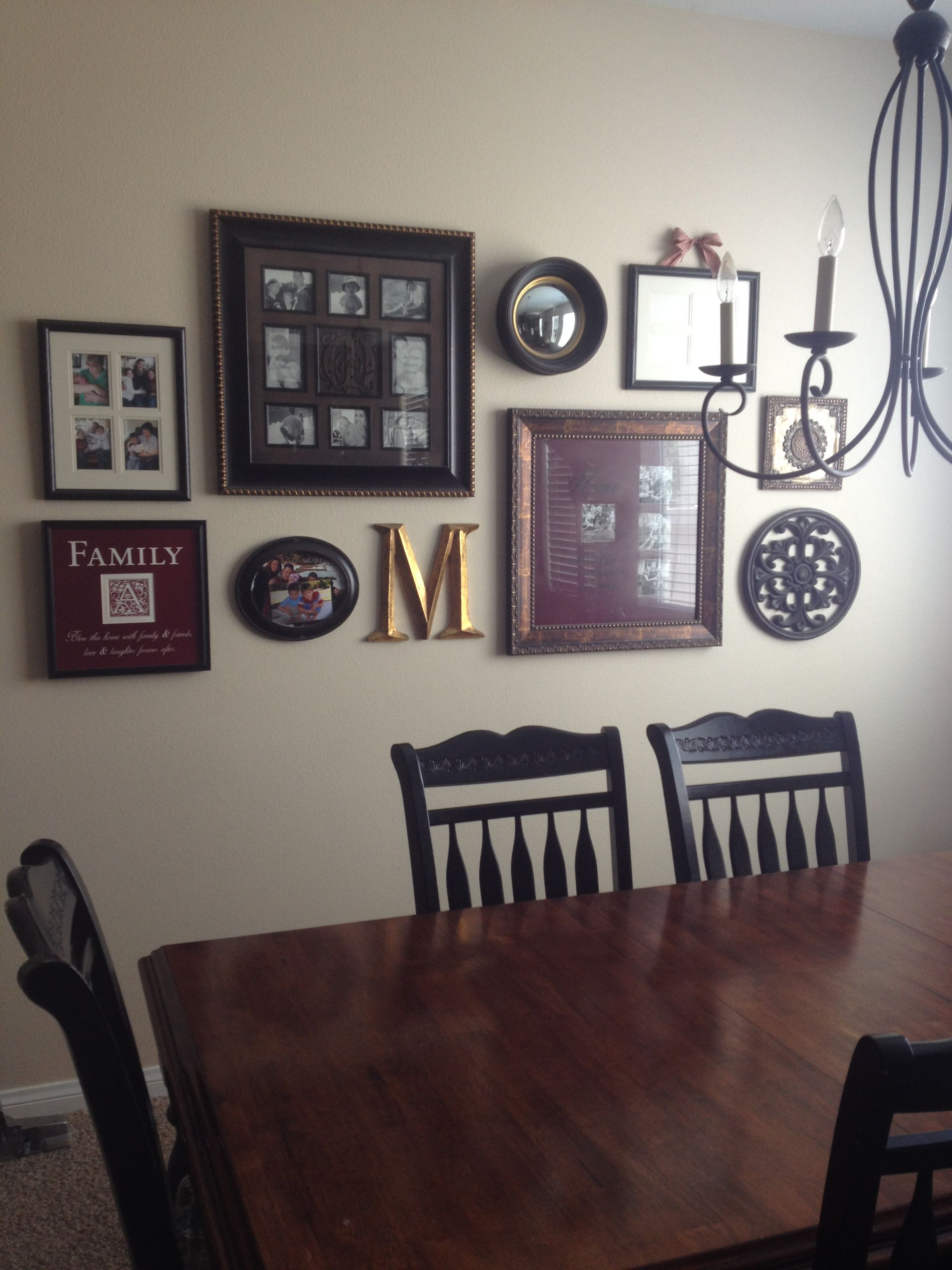 Photo wall collage using multi photo frames and assorted hobby lobby