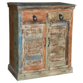 "Distressed 2-drawer mango wood sideboard with a storage shelf behind 2 textured Indian-print doors.   Product: SideboardConstruction Material: Mango woodColor: MultiFeatures: Two textured Indian-print doorsTwo drawers and one interior shelfDimensions: 37"" H x 36"" W x 14"" D"