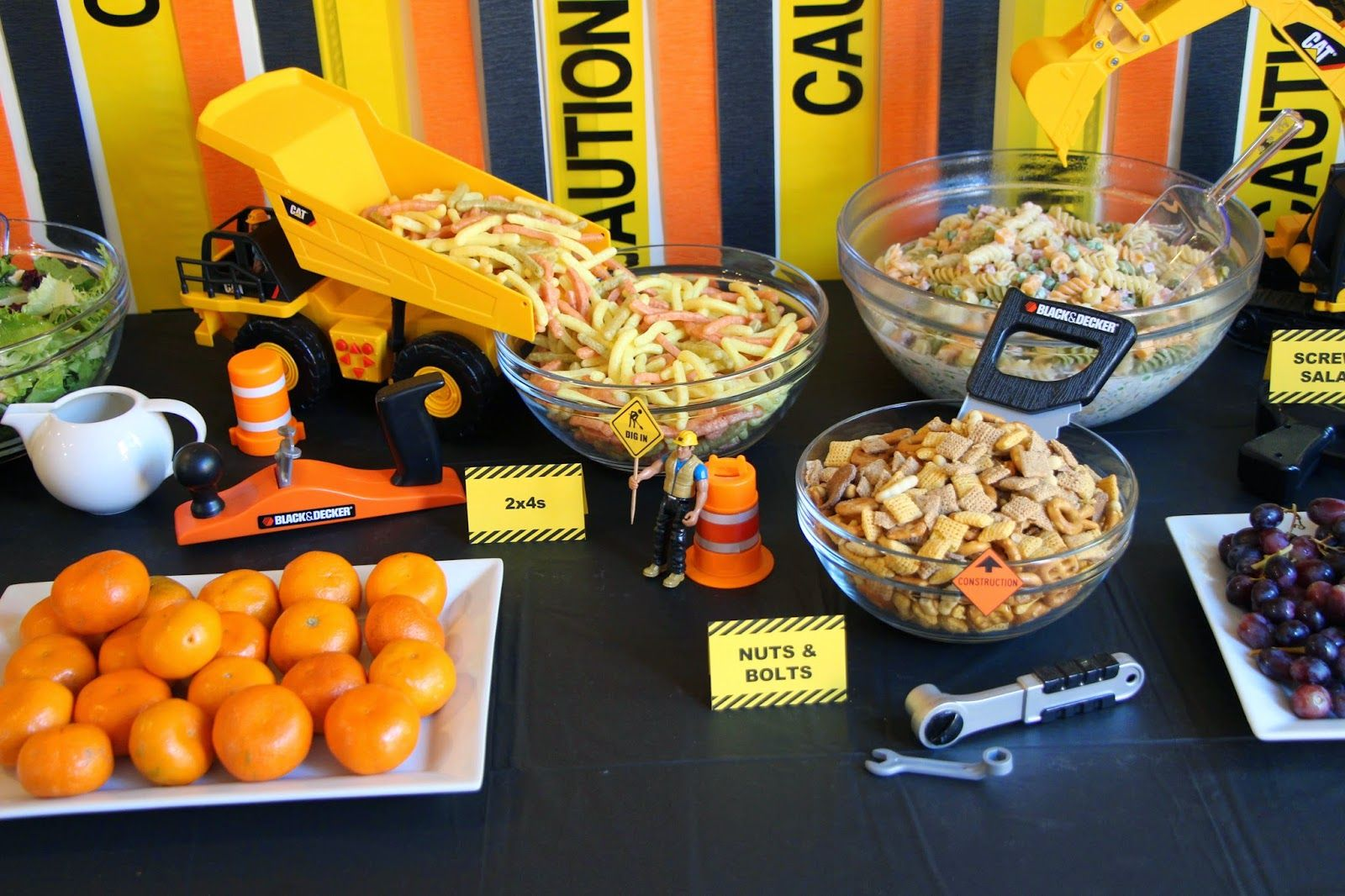 Construction birthday party food table 2x4s nuts and