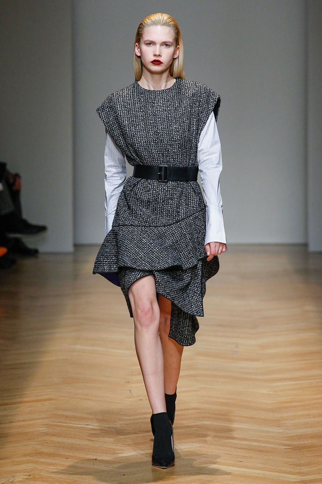 Masculine wool tweed fabric creating unconventional asymmetrical dress on AquilanoRimondi FW2017-18 runway.