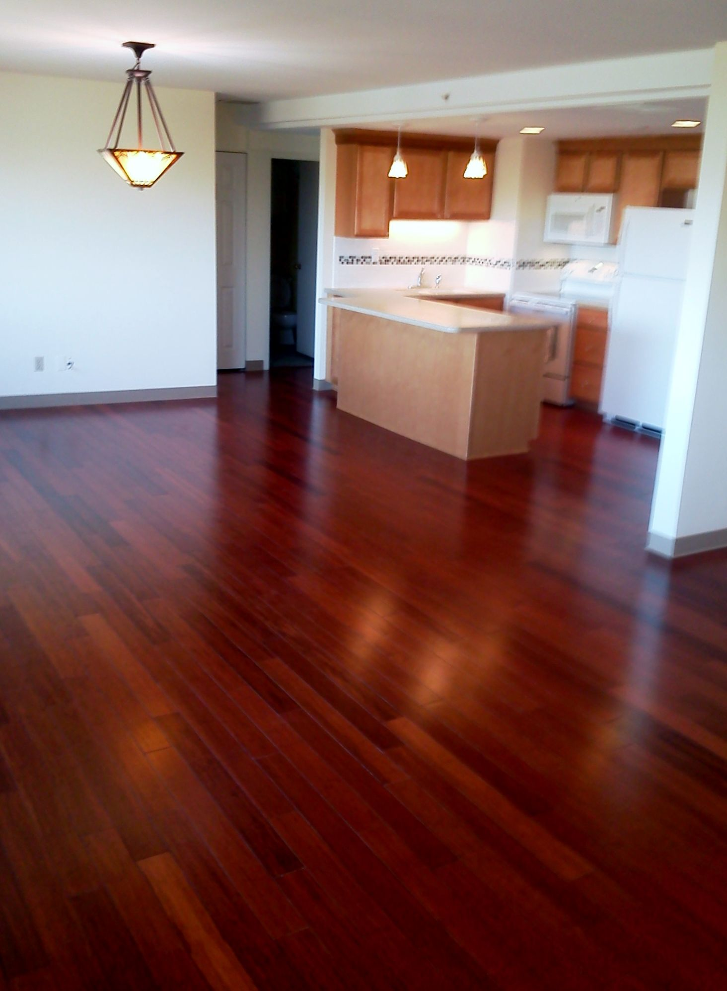 beautiful bamboo flooring with a cherry stain open floor plan beautiful bamboo flooring with a cherry stain open floor plan birch cabinetry and solid surface