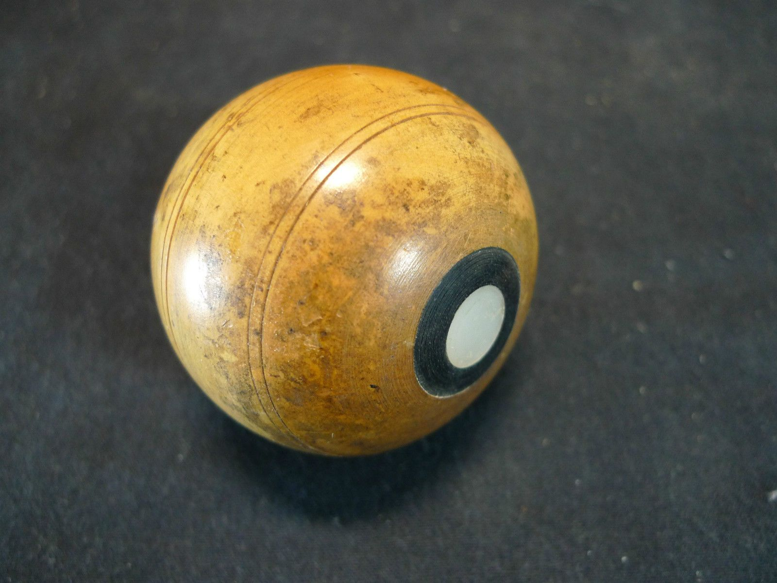 19th century boxwood spinning top with brass tip inlaid with mother of pearl and ebony