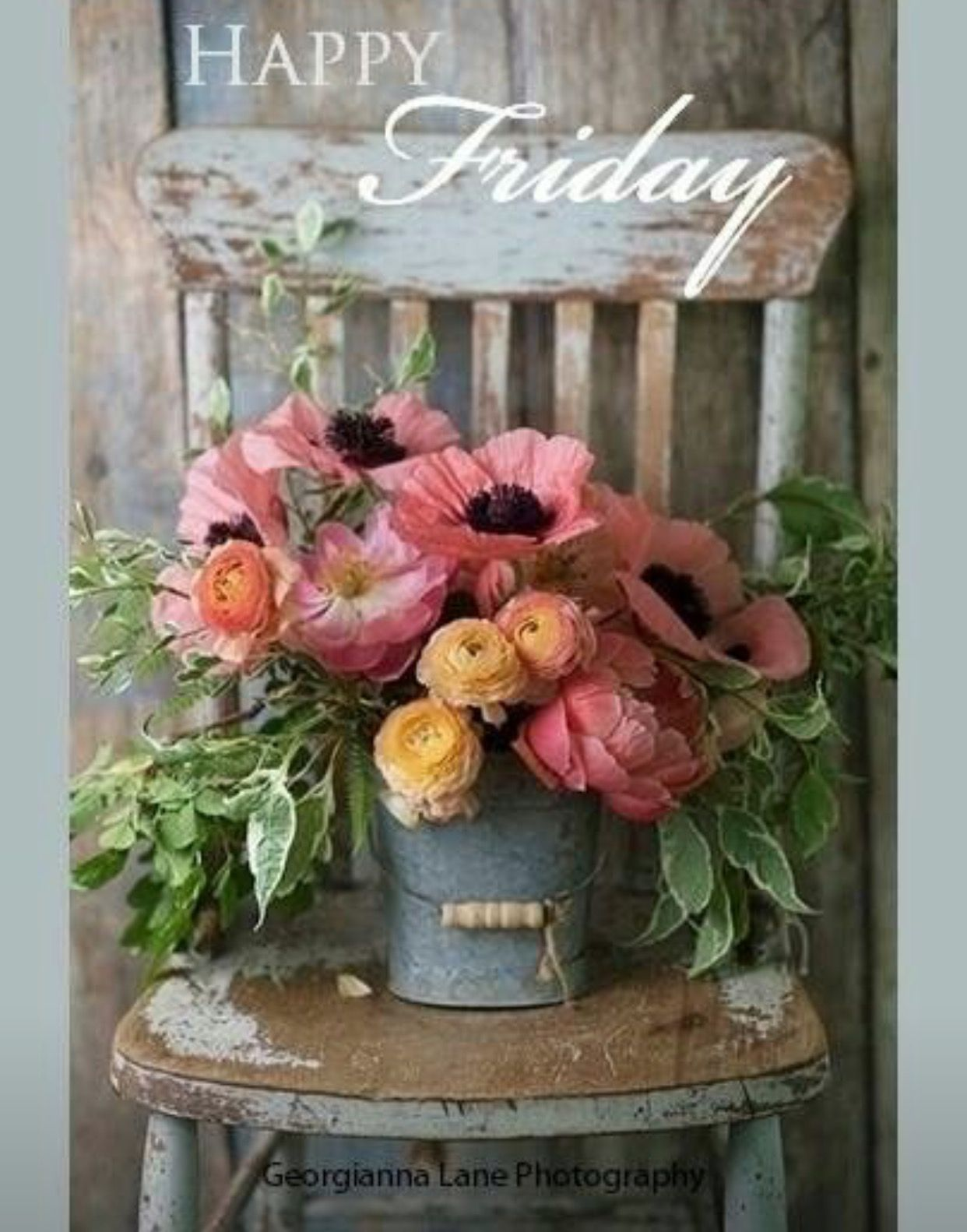 Beautiful Flower Arrangement On Galvanized Bucket And Vintage Chair