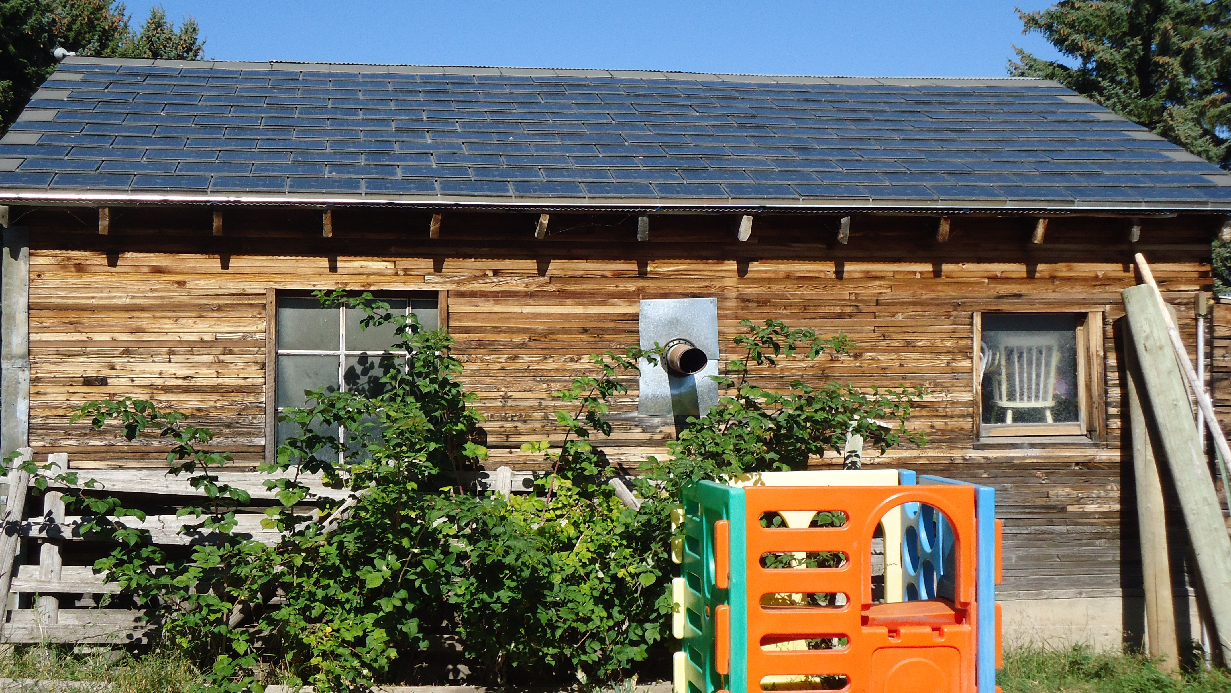 Solar Shingles For Tiny Houses Turn Your Whole Roof Into A Solar Collector Solar Shingles Solar Roof Solar