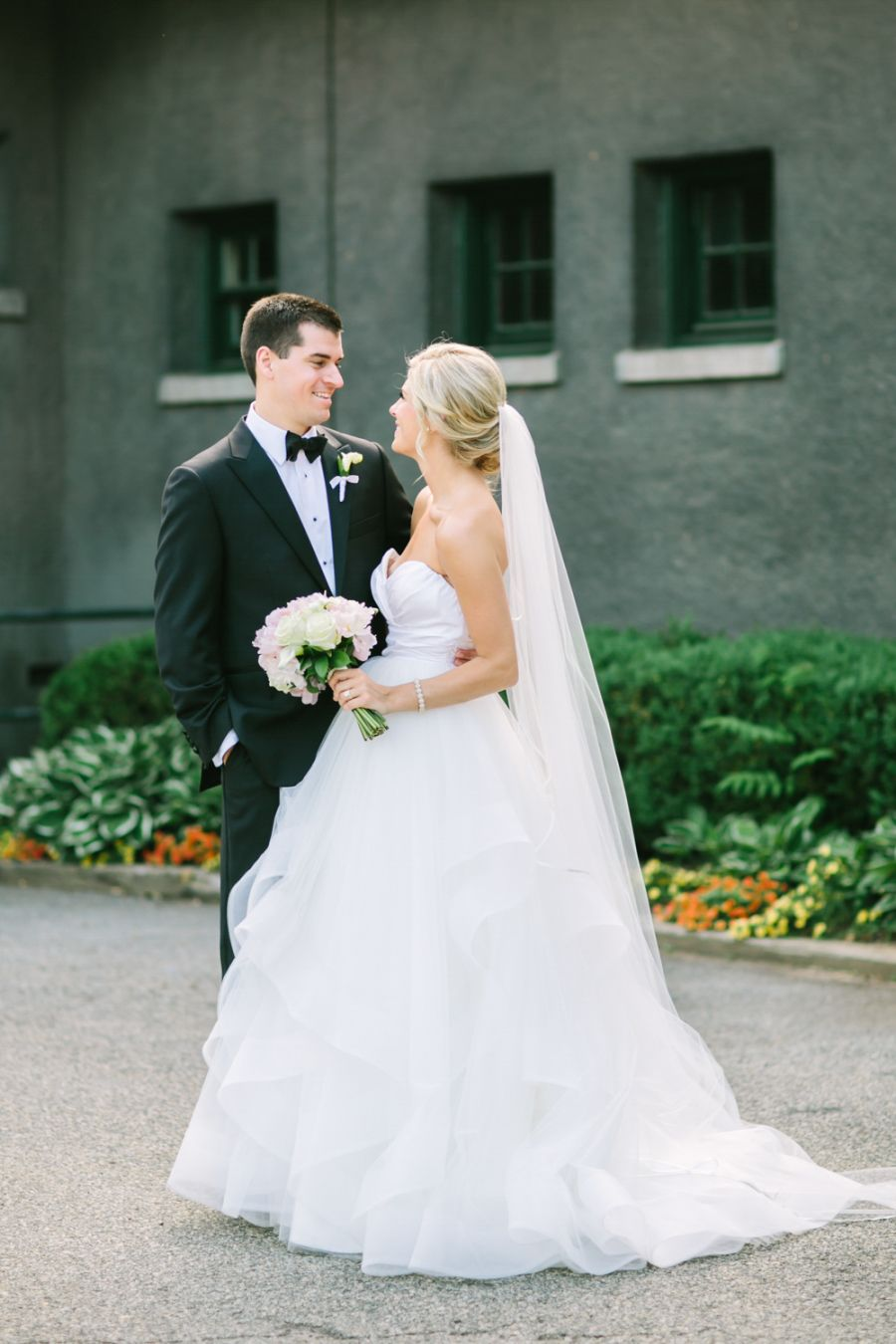 Photography: Love & Light Photographs - www.loveandlightphotographs.com Floral Design: Jardiniere Fine Flowers - jfineflowers.com Wedding Dress: Hayley Paige - www.jlmcouture.com/Hayley-Paige   Read More on SMP: http://www.stylemepretty.com/2016/02/29/classic-black-tie-wedding-with-pretty-pink-peonies/