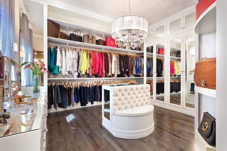 Fabulous Walk In Closet Features White Sheer Drum Chandelier With Crystal Drops Over Mirrored Island Built Bench Across From Wall Of Stacked