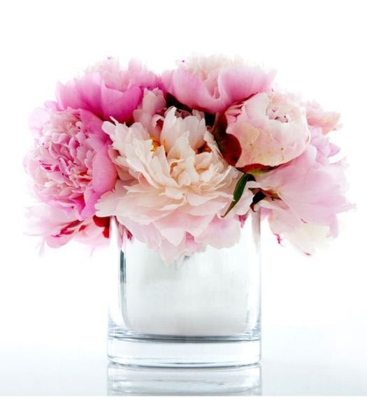 I have these exact water vases and used this same idea for anniversary party tables