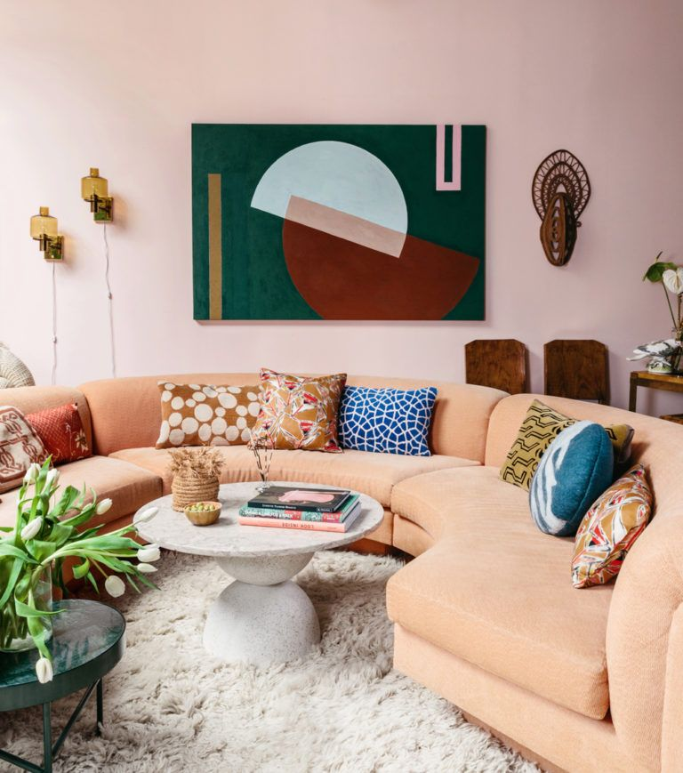 These Two Sisters Live Together In A Color Explosion A Cup Of Jo In 2020 Living Room Remodel Curved Sofa Interior
