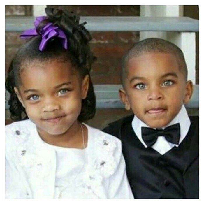 Beautiful eyes of twins,  boy and girl.
