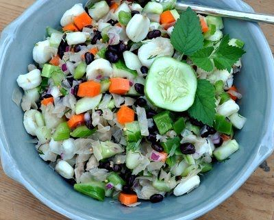 A classic sauerkraut salad recipe, lightened, brightened with vegetables, hominy and black beans.