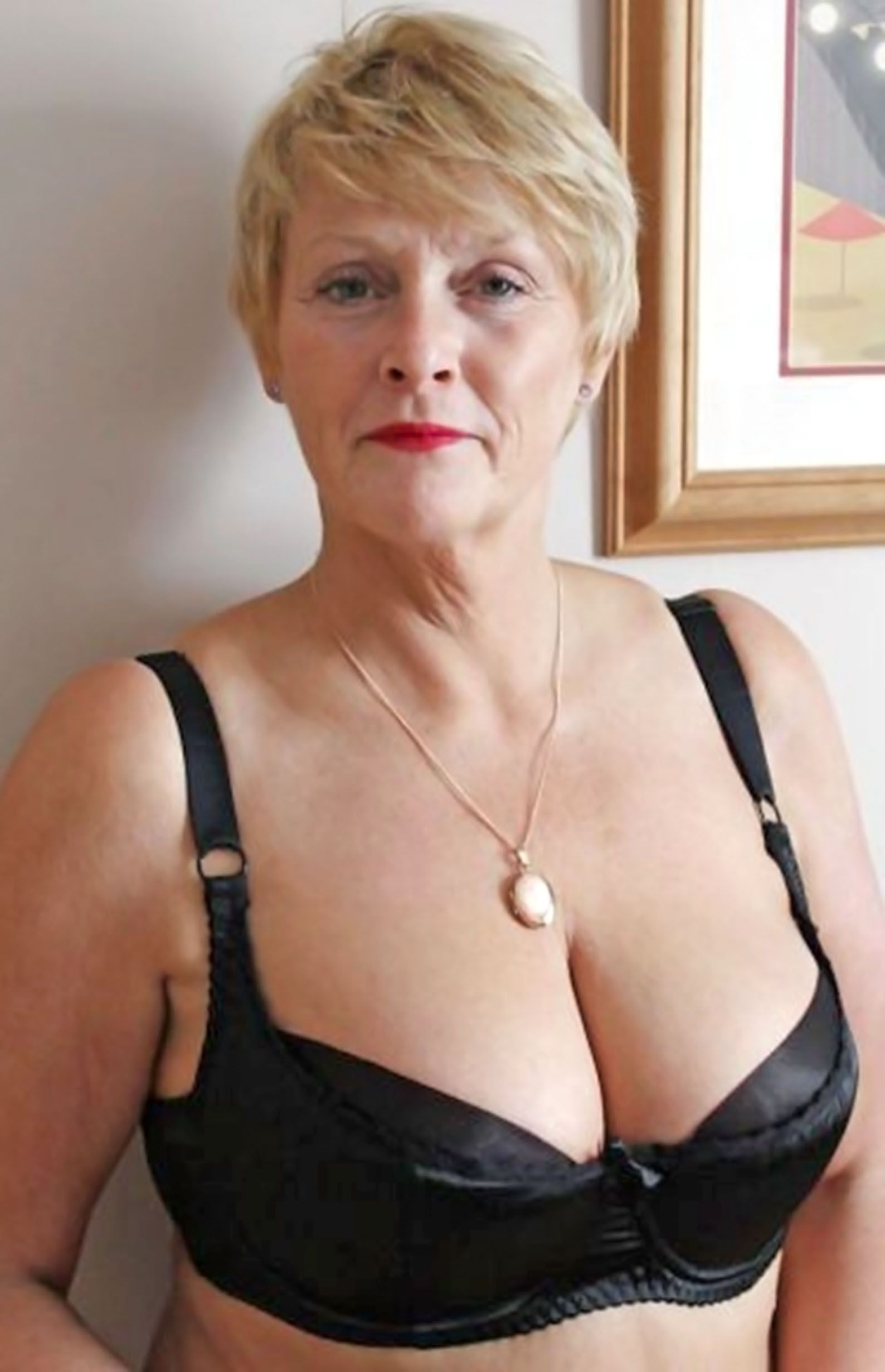 Mature blonde big tits