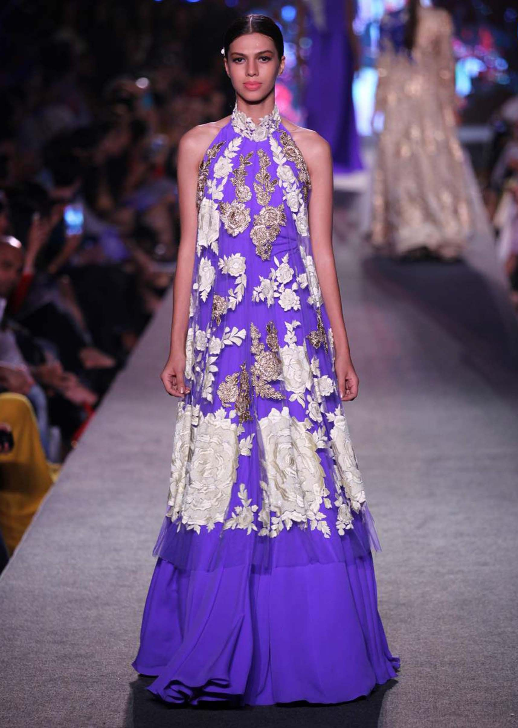 Model walks the ramp in purple lehenga with long embroidered blouse ...